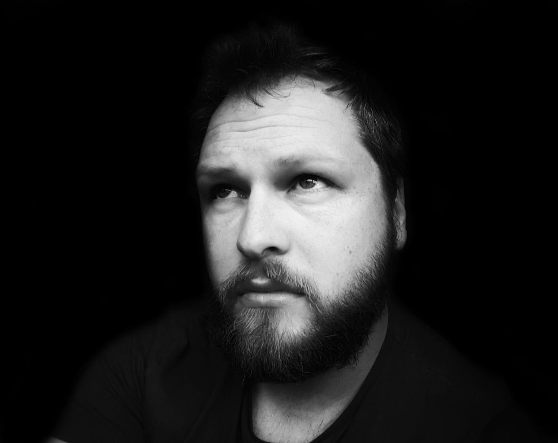 Black and White portrait image of awards winning Manchester writer film director, cinematographer and fashion advertising filmmaker David Ellison